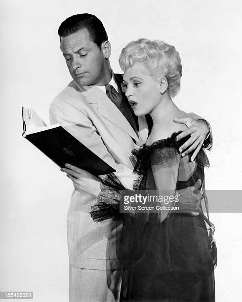 American actor William Holden as Paul Verrall and American actress Judy Holliday as Emma 'Billie' Dawn in 'Born Yesterday' directed by George Cukor...