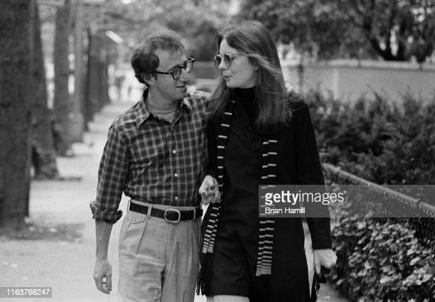 American actor Woody Allen and Diane Keaton walk along a street in a scene from their film 'Annie Hall' New York New York 1977
