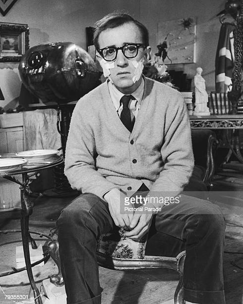 American actor, writer, comedian and director Woody Allen with surgical dressings on each cheek, 1965. He is in Paris to film 'What's New, Pussycat',...