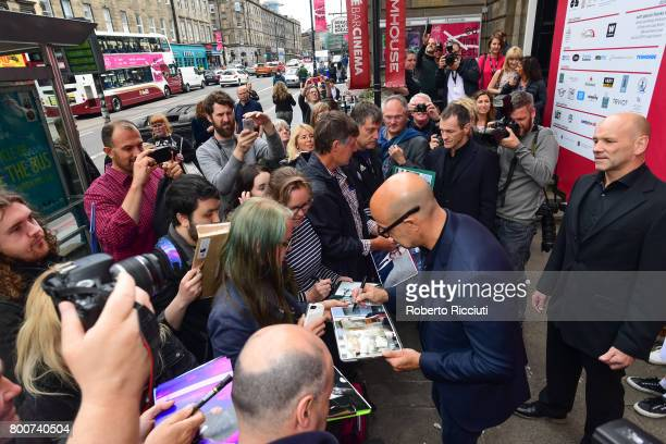 American actor writer producer and film director Stanley Tucci signs autographs to fans after the photocall for the event 'In Person Stanley Tucci'...