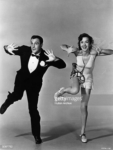 American actordancer Gene Kelly rehearsing with Debbie Reynolds for the MGM musical 'Singin' In The Rain' directed by Gene Kelly and Stanley Donen