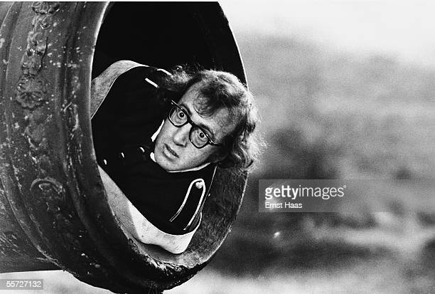 American actor-director Woody Allen prepares to be fired from a cannon during filming of his comedy 'Love and Death', set during the Napoleonic Wars,...