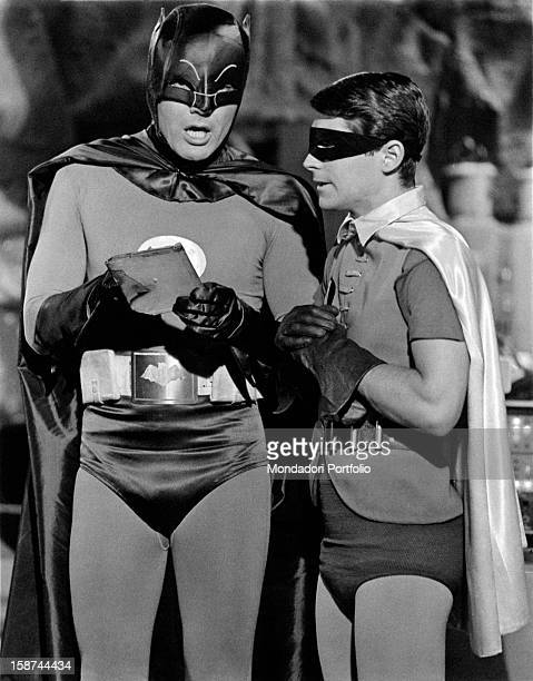American actors Adam West and Burt Ward wearing the costumes of the comics superheroes Batman and Robin and acting in the TV serie Batman. 1966