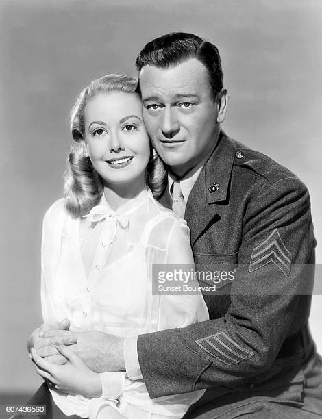 American actors Adele Mara and John Wayne American actor John Wayne on the set of Sands of Iwo Jima directed by Allan Dwan