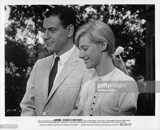 Alan Arkin with Sondra Locke at formal event in a scene from the film 'The Heart Is A Lonely Hunter' 1968