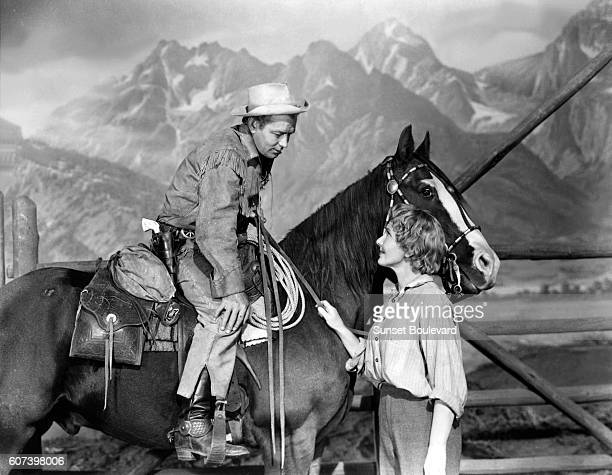 American actors Alan Ladd and Jean Arthur on the set of Shane directed by George Stevens