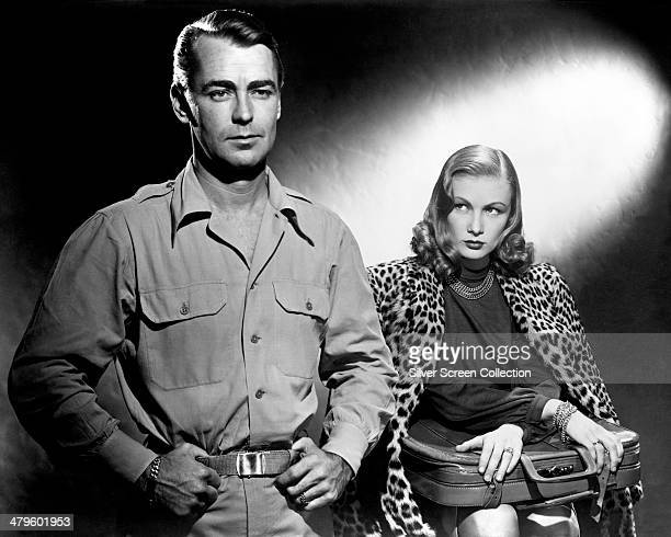 American actors Alan Ladd and Veronica Lake in a promotional portrait for 'Saigon', directed by Leslie Fenton, 1948.