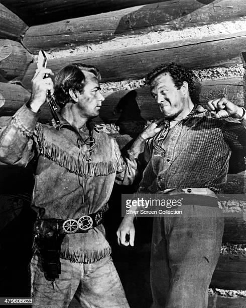 American actors Alan Ladd as Shane and Van Heflin as Joe Starrett, in a fight scene from 'Shane', directed by George Stevens, 1953.