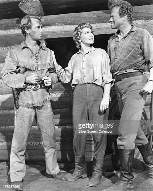 American actors Alan Ladd as Shane Jean Arthur as Marian Starrett and Van Heflin as Joe Starrett in a publicity still for 'Shane' directed by George...