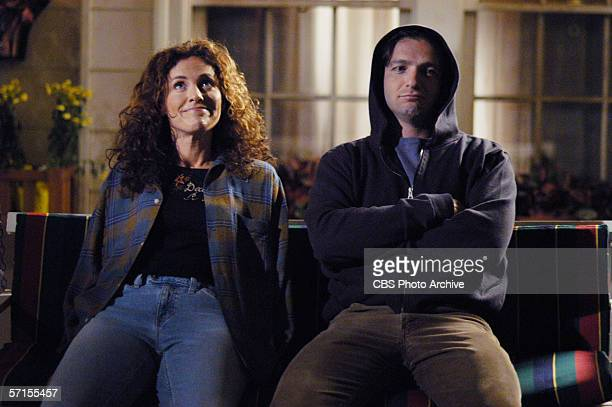 American actors Amy Brenneman and Dan Futterman sit on a porch swing and enjoy each other's company in a still from episode 'Accountability' the...