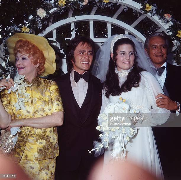 American actors and comedians Lucille Ball and her former husband, Cuban-born actor and bandleader Desi Arnaz , pose with their daughter, Lucie...