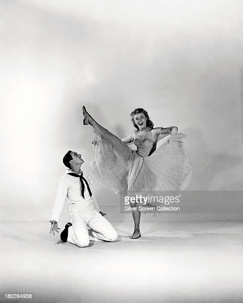 American actors and dancers Gene Kelly and VeraEllen in a promotional still for 'On The Town' directed by Kelly and Stanley Donen 1949