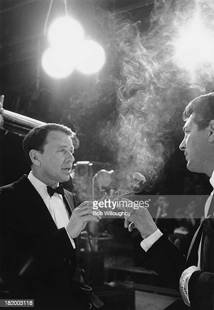 American actors and singers Frank Sinatra and Dean Martin on the set of an NBC TV programme, circa 1962.