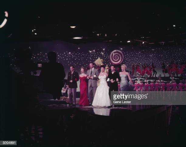 American actors and singers Johnnie Ray Mitzi Gaynor Dan Dailey Ethel Merman Donald O'Connor and Marilyn Monroe in a still from the grand finale of...