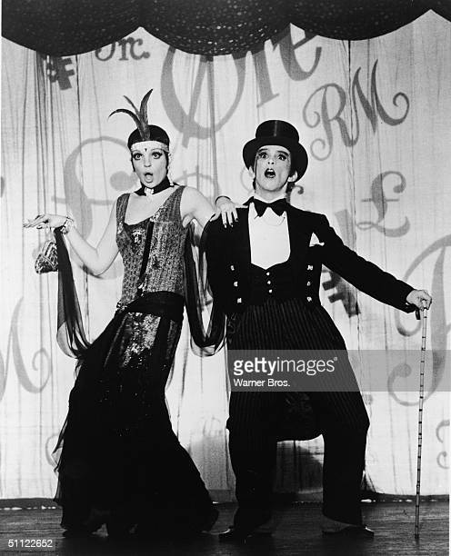 American actors and singers Liza Minnelli and Joel Grey perform on stage as nightclub performers in Germany during the Weimar Republic in the film...