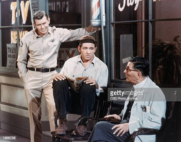American actors Andy Griffith George Lindsey and Howard McNear sit outside a barber shop in a still from the television series 'The Andy Griffith...