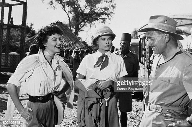 American actors Ava Gardner Grace Kelly and Clark Gable on the set of Mogambo directed by John Ford