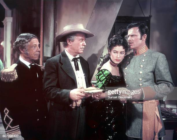 American actors Ava Gardner Joe EBrown and Howard Keel on the set of Show Boat directed by George Sidney