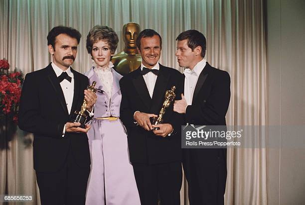 American actors Barbara Rush and Robert Morse pictured with producers Trevor Greenwood and Pierre Schoendorfer holding their respective Academy...