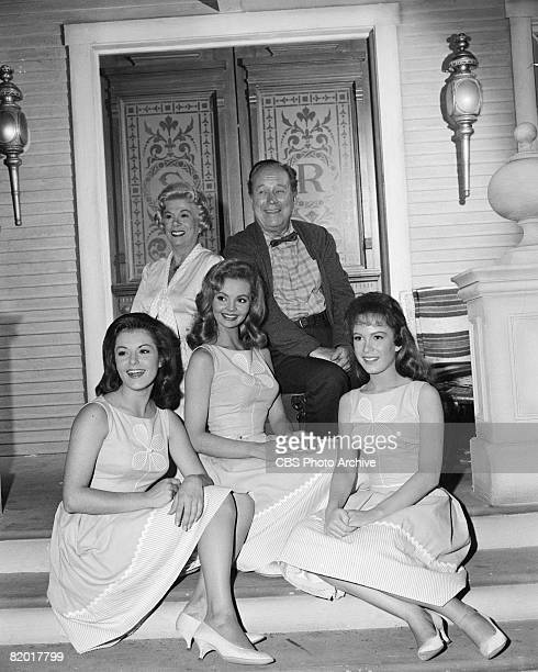 American actors Bea Benaderet as Kate Bradley and Edgar Buchanan as Joseph P 'Uncle Joe' Carson pose with American actresses front row from left...