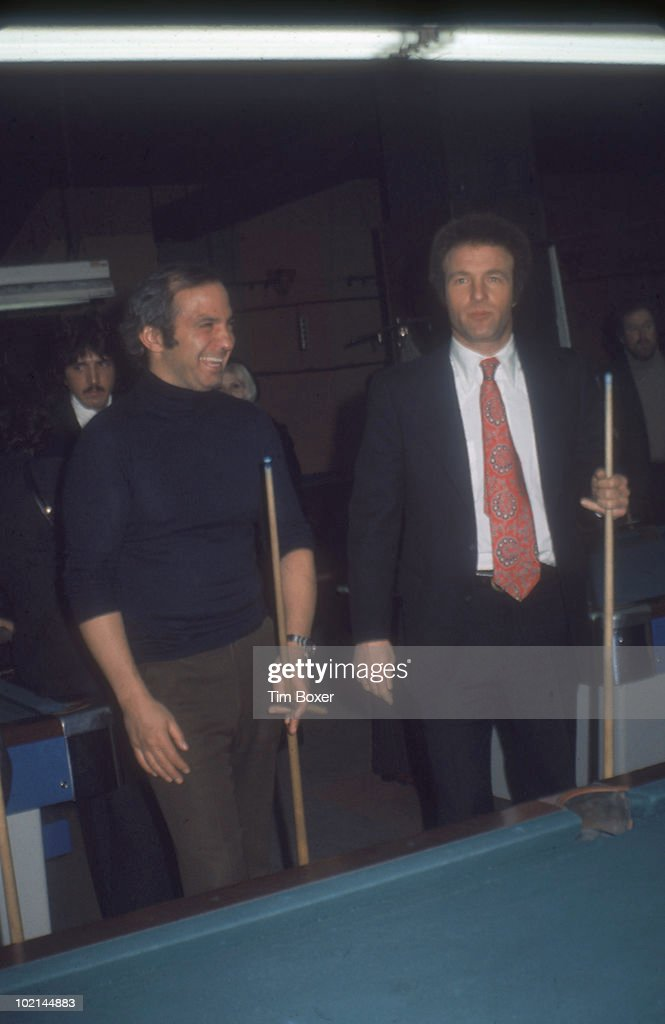 American actors Ben Gazzara (left) and James Caan play pool at Gallagher's restaurant during the premiere party for Caan's film 'Cinderella Liberty,' New York, New York, December 15, 1973.