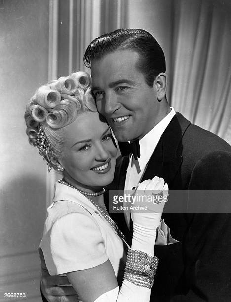 American actors Betty Grable and John Payne during a scene from 'The Dolly Sisters' a Twentieth Century Fox musical film