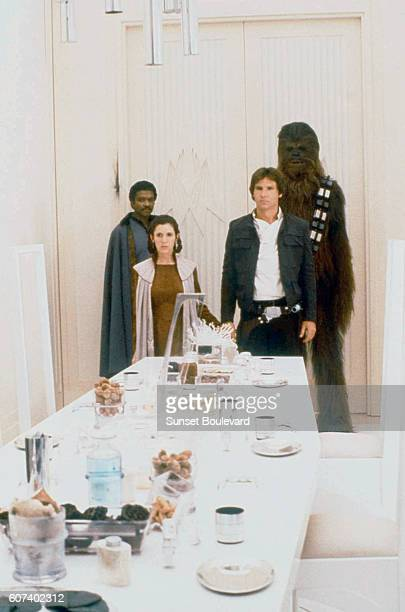 American actors Billy Dee Williams Carrie Fisher Harrison Ford and British Peter Mayhew on the set of Star Wars Episode V The Empire Strikes Back...