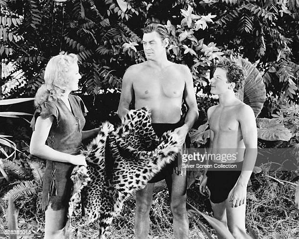 American actors Brenda Joyce as Jane Johnny Weissmuller as Tarzan and Johnny Sheffield as Boy in 'Tarzan And The Leopard Woman' directed by Kurt...