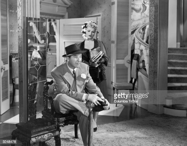 American actors Broderick Crawford and Judy Holliday in a still from director George Cukor's film 'Born Yesterday'