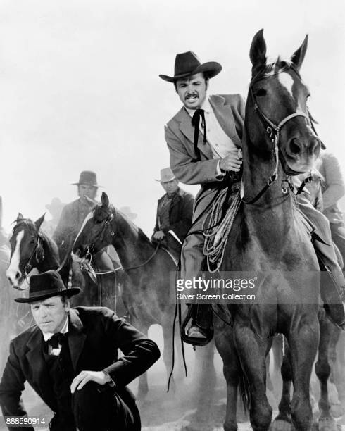 American actors Burt Lancaster and Audie Murphy , and horses, in a scene from 'The Unforgiven' , Durango, Mexico, 1960.