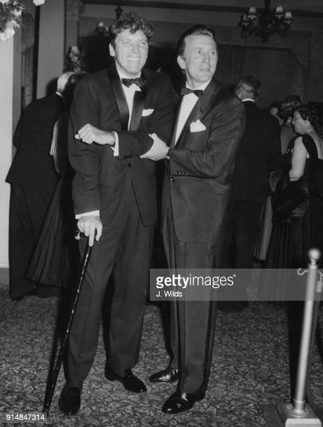 American actors Burt Lancaster and Kirk Douglas arrive at the Leicester Square Theatre for the London premiere of the film 'The Vikings' 8th July...