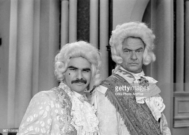 American actors Burt Reynolds and Harvey Korman , both in ruffled shirts and wigs, appear on an episode of the television comedy & variety program...