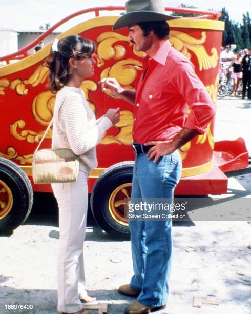 American actors Burt Reynolds as Bo Darville and Sally Field as Carrie in 'Smokey And The Bandit' directed by Hal Needham 1977