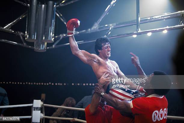 American actors Burt Young Carl Weathers and actor director screenwriter and producer Sylvester Stallone on the set of Stallone's movie Rocky III
