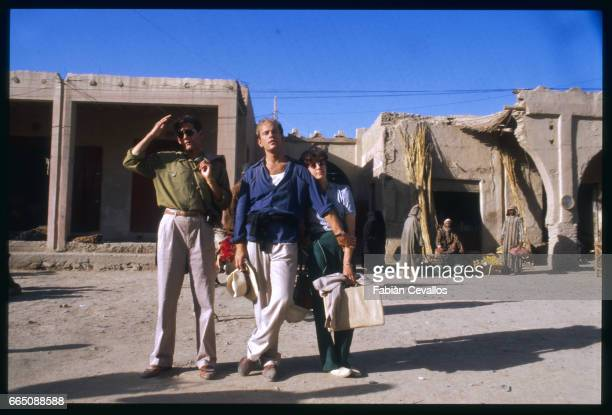 American actors Campbell Scott John Malkovitch and Debra Winger with their luggage in a village street during the shooting of the movie Un The au...