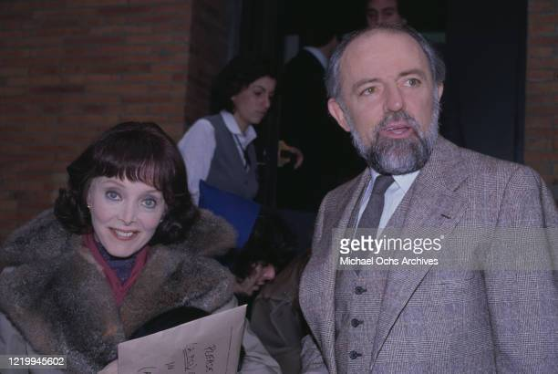 American actors Carolyn Jones and John Astin attend an event, US, circa 1995.