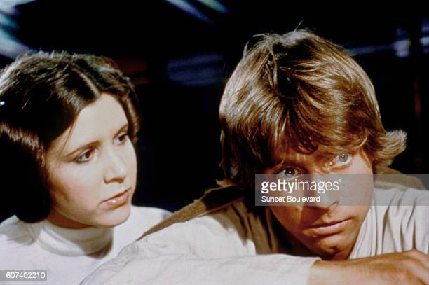 American actors Carrie Fisher and Mark Hamill on the set of Star Wars Episode IV A New Hope written directed and produced