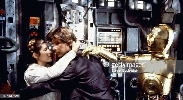 American actors Carrie Fisher Harrison Ford and British Anthony Daniels on the set of Star Wars Episode V The Empire Strikes Back directed by Irvin...