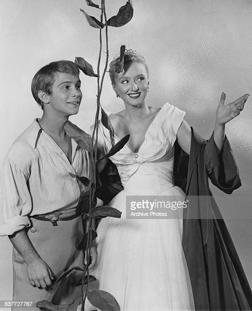 American actors Celeste Holm and Joel Grey as 'Jack' in stage costume for their roles in 'Jack and the Beanstalk', circa 1956.