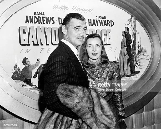 American actors Clark Gable and Ella Raines at the premiere of Jacques Tourneur's 'Canyon Passage' USA July 1946 Behind them is a poster for the film