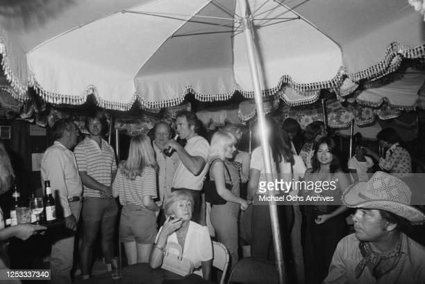 American actors Clint Eastwood and John Quade at the Palomino Club in North Hollywood California during a party for the film 'Any Which Way You Can'...