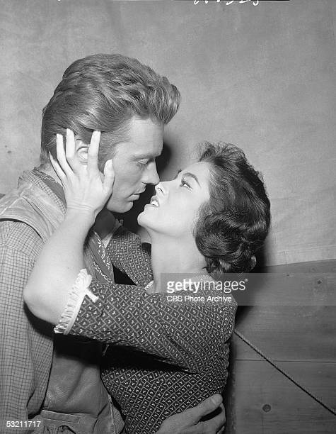 American actors Clint Eastwood and Nancy Hadley share a kiss on the set of 'Rawhide' 1958