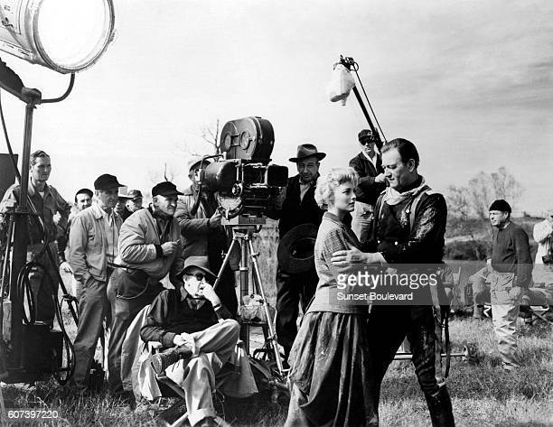 American actors Constance Towers and John Wayne with director John Ford on the set of his movie The Horse Soldiers