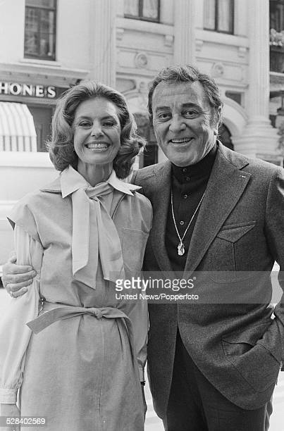 American actors Cyd Charisse and Tony Martin posed together outside the Palladium in London on 8th September 1977