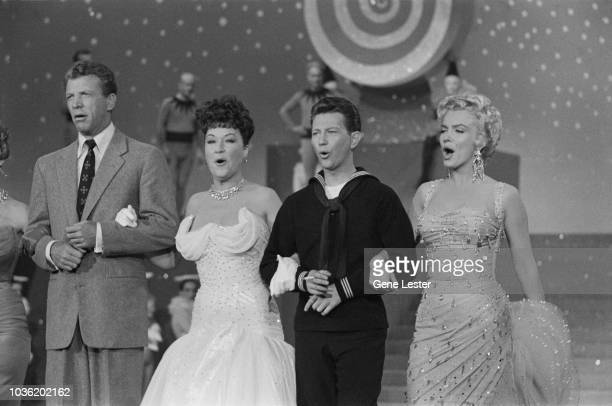 American actors Dan Dailey Ethel Merman Donald O'Connor and Marilyn Monroe performing on the set of 'There's No Business Like Show Business' directed...