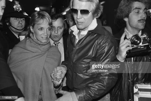 American actors David Soul and Lynne Marta surrounded by photographers and police as they arrive at Heathrow Airport London UK 11th March 1977