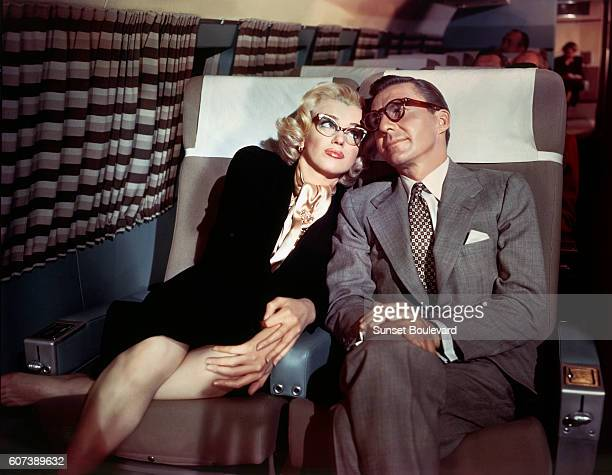 American actors David Wayne and Marilyn Monroe on the set of How to Marry a Millionaire directed by Jean Negulesco