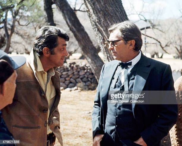 American actors Dean Martin and Robert Mitchum on the set of the western '5 Card Stud' directed by Henry Hathaway 1968