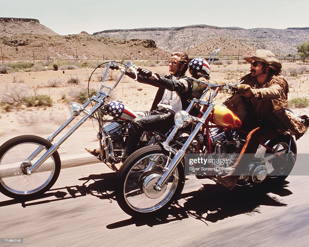 American actors Dennis Hopper and Peter Fonda ride through the Desert on motorcycles in a scene from the film 'Easy Rider', directed by Hopper, 1969.