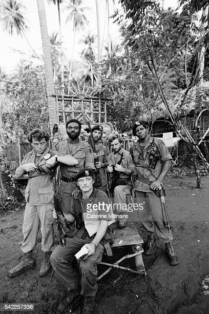 American actors Dennis Hopper Kerry Rossall Albert Hall Scott Glenn and Laurence Fishburne on the set of the film Apocalypse Now directed by Francis...